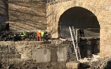 Completing towpath under bridge