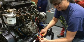 Repairing boat engine electrics