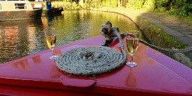 Two glasses of champagne on the bow of a narrowboat