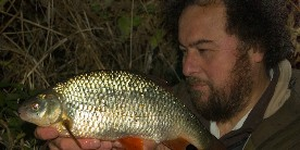 Dr Mark Everard with a roach of over 3lb, a 'holy grail' for the serious specimen angler