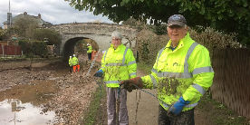 Volunteers assisting with rubbish removal from the canal bed at Middlewich