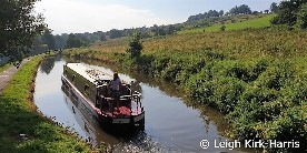 Boating on the Caldon Canal, a narrowboat approaching a lock