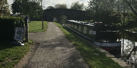 towpath alongside canal with narrowboat