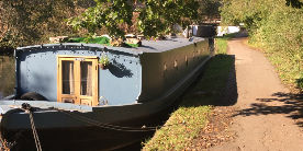 boat alongside canal towpath