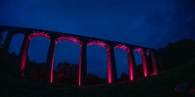 Pontcysyllte Aqueduct illuminated with fuschia lighting