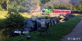 Narrowboat and steam train at Consall forge