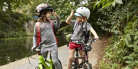 Children high-fiving on the towpath