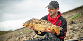 Angler Adam Rooney with a carp at Harthill Reservoir
