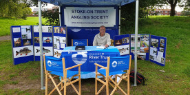 Roy Bailey of Stoke on Trent AS sitting in tent welcoming new anglers