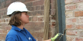 Iona helping to preserve brickwork using tools