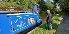 Waterways Chaplain the Rev. Pat Willis chats with the Wessex Rose Hotel Boat