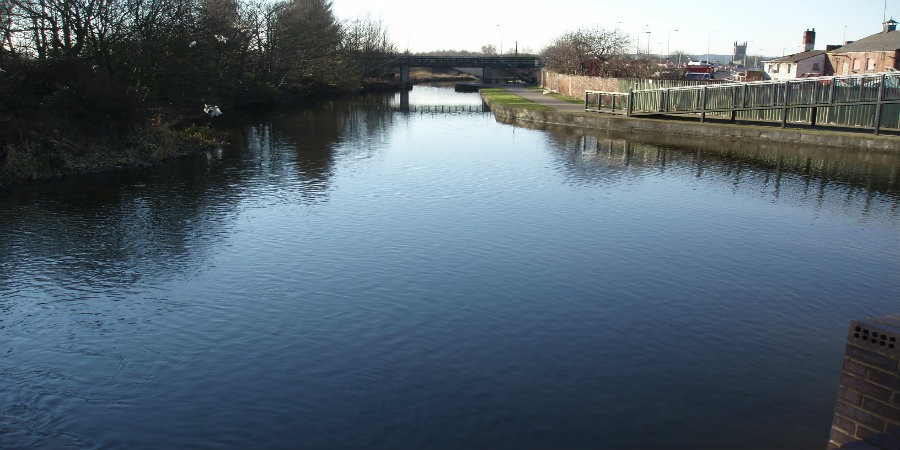 View down Leigh Branch of Leeds & Liverpool Canal with bridge in background