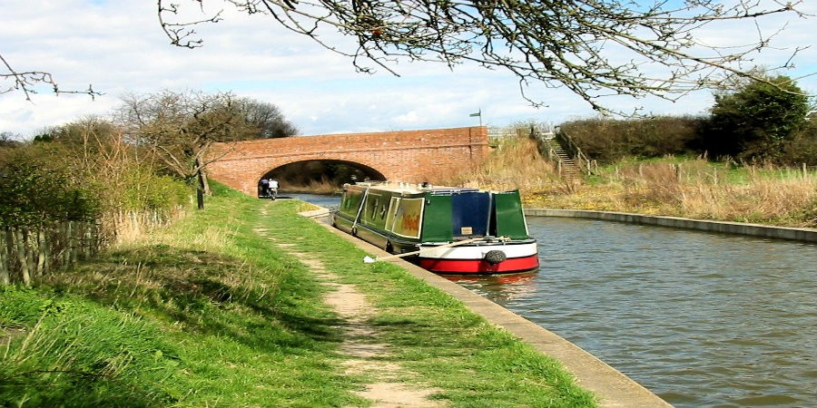 Boat moored in front of Little Tring Bridge on Wendover Arm of Grand Union Canal