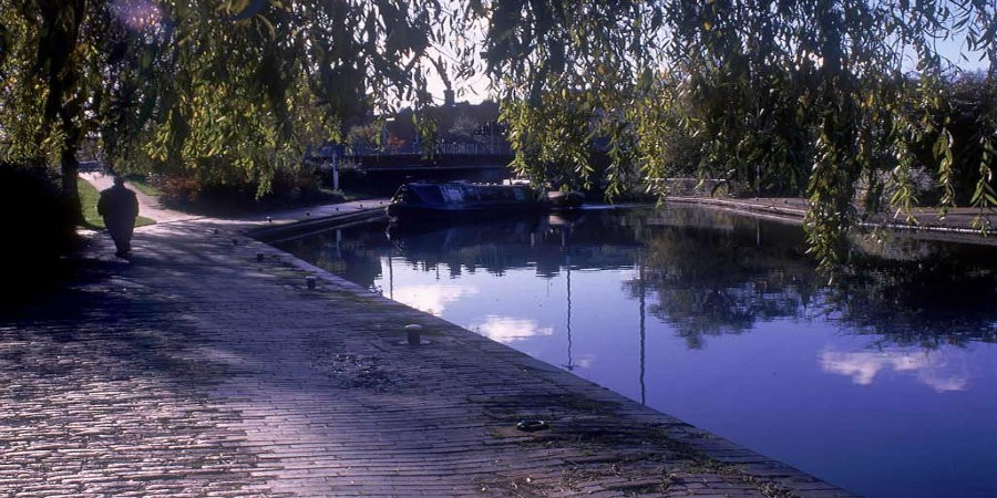 Person walking along towpath by Walsall Canal