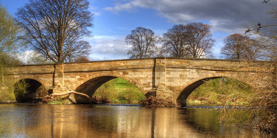 Stone bridge crossing River Ure