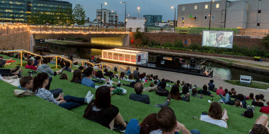 Members of the public watching The Floating Cinema at Kings Cross