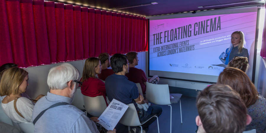 People in the Floating Cinema watching a presentation