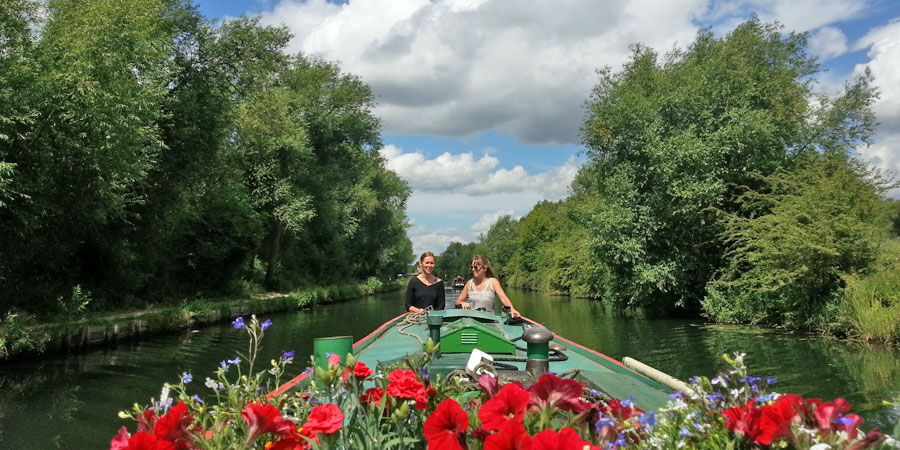 A narrowboat cruising along the canal