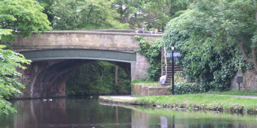 People walking across Moor Lane bridge on Lancaster Canal