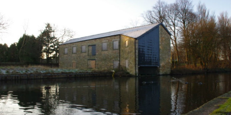 Boathouse with angular roof on banks of Lancaster Canal