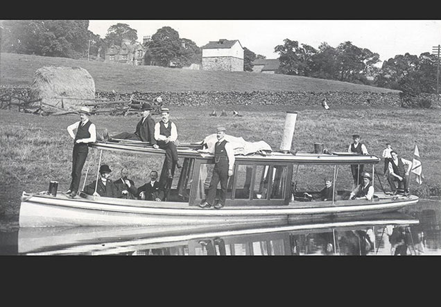 Canal company launch Alexandra with company directors above Five Rise Locks with Gawthorpe Hall visible in the background.