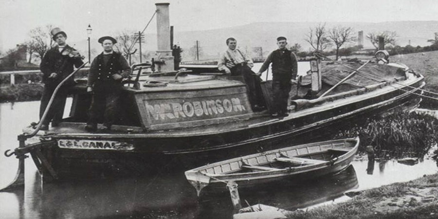 Black and white photo of boatmen on a workboat
