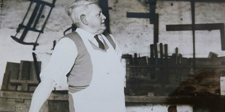 Black and white photo of Will Hodgson in carpenter's shop at Five Rise