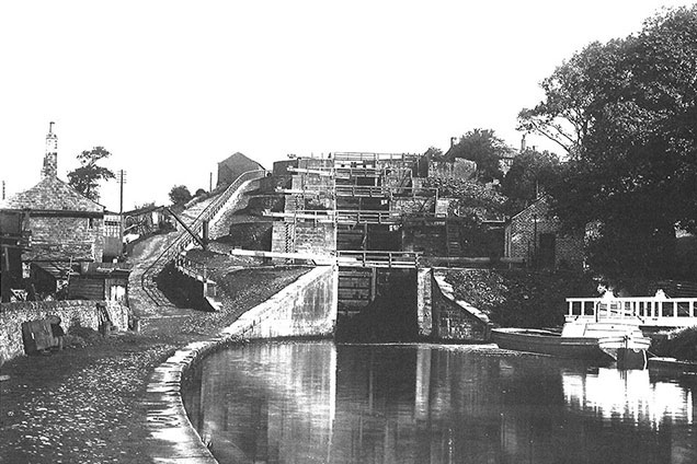 Black and white photo showing FIve Rise locks with Five Rise house at bottom