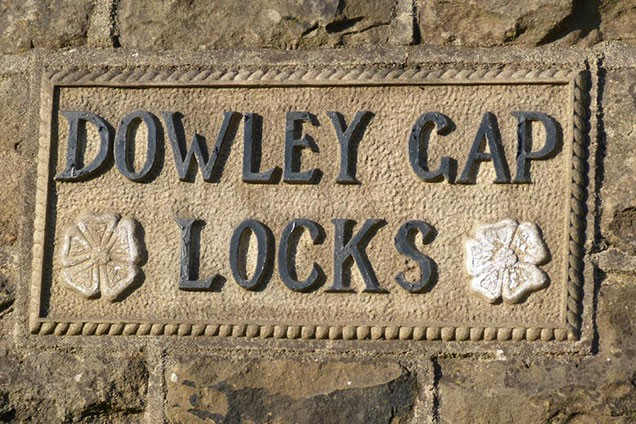 Plaque with white rose of Yorkshire installed at Dowley Gap during lock restoration in 1980s