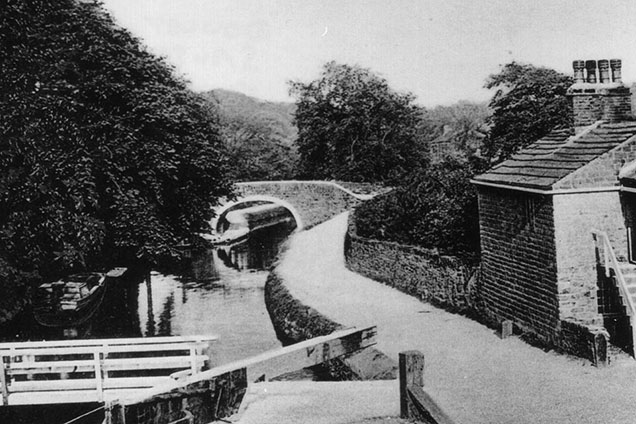 Black and white photo of Changeline Bridge and old lock keepers cottage at Dowley Gap around 1930