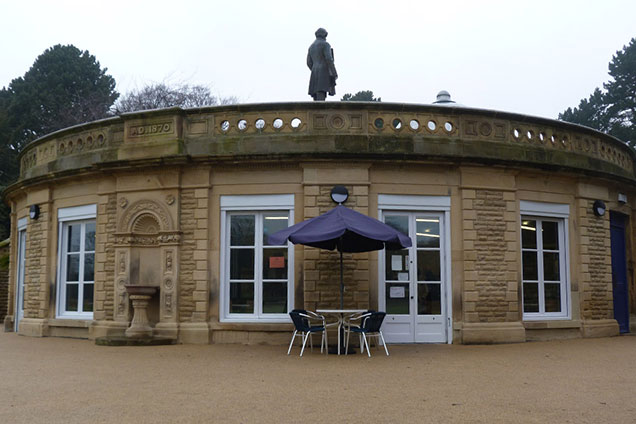 Half Moon Cafe, the former cricket pavilion, with a statue of Sir Titus Salt on top.