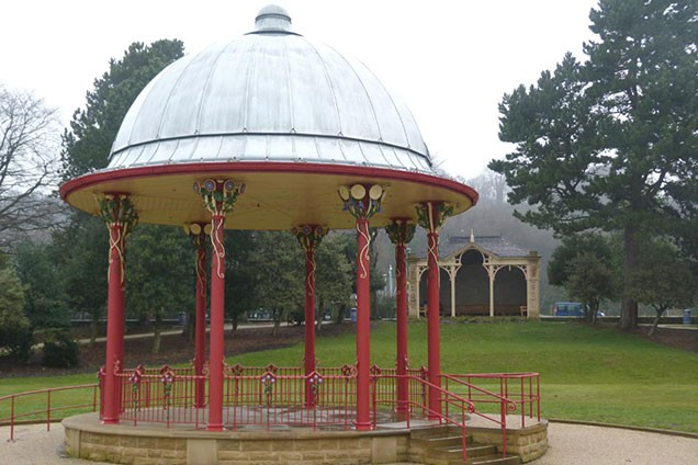 Bandstand wtih red columns and railings in Roberts Park