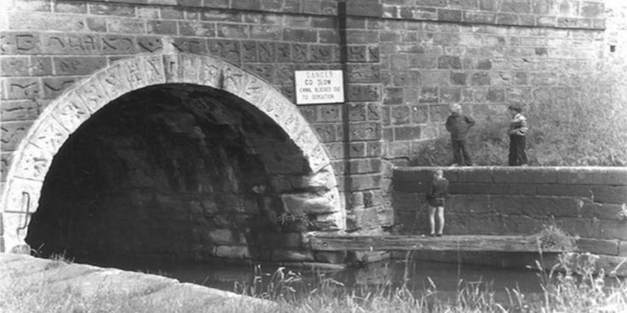 Black and white photo of children stoof by mouth of Gannow Tunnel