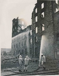 Firefighters working at clock tower mill