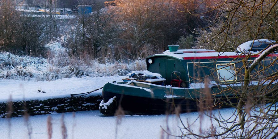 A boat moored in the snow