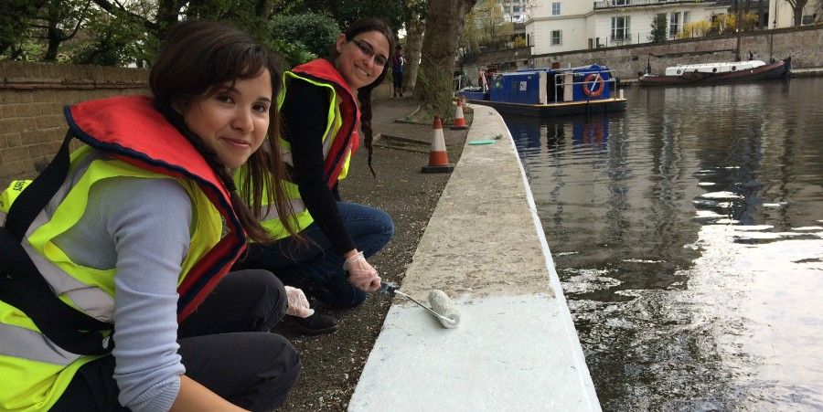 Volunteers from British Land paint coping stones