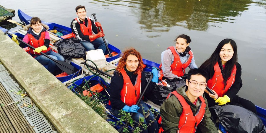 Student volunteers on a boat