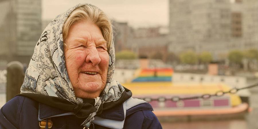 Elderly lady smiling by the water