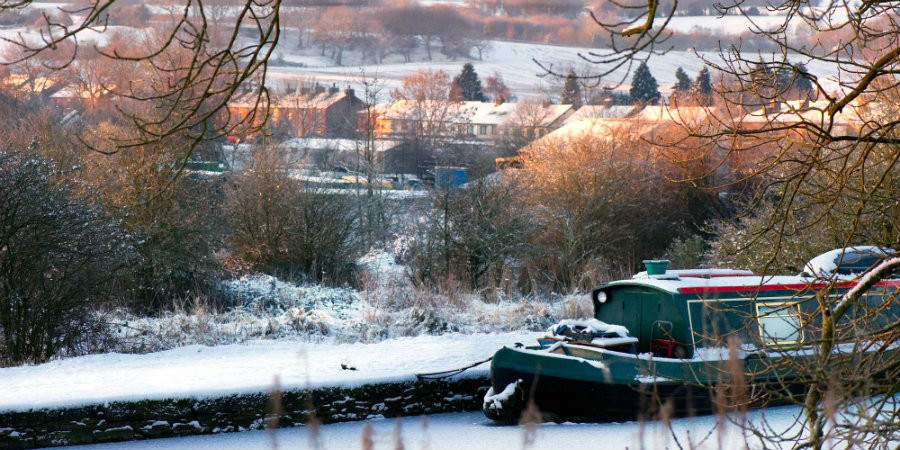 Snowed in narrowboat on the canal at Apperley Bridge