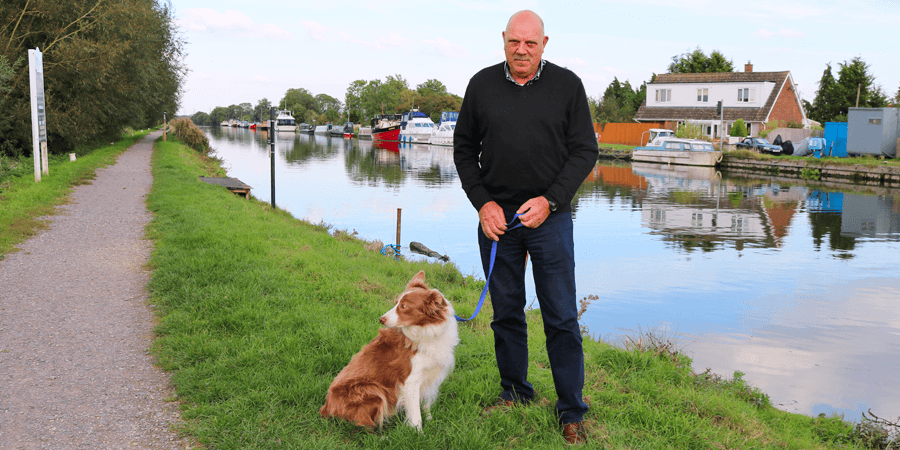 Man and dog by canal