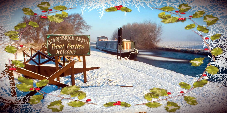 Boat moored near the Scarisbrick Arms in the snow