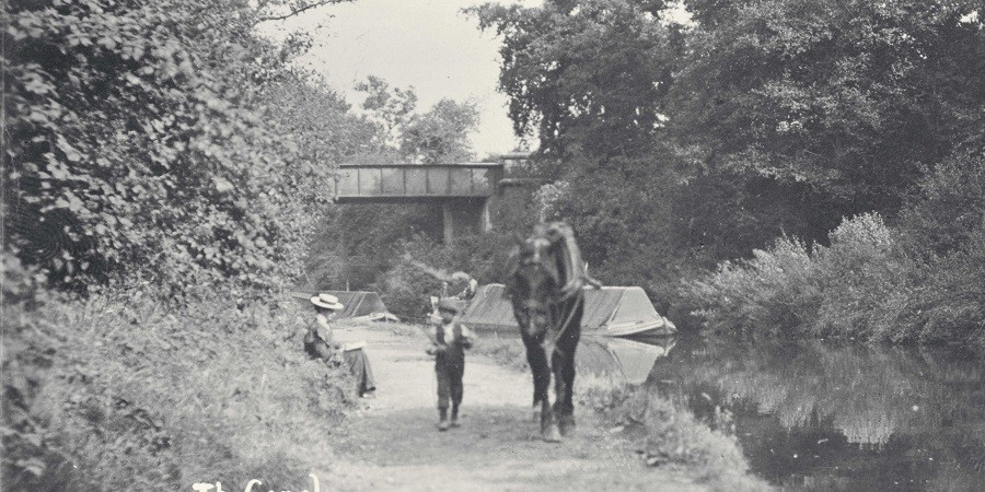 Boy and horse towing boat