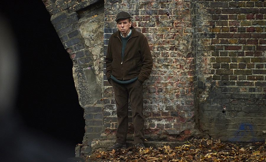 Photo of Timothy Spall standing next to the Islington Tunnel