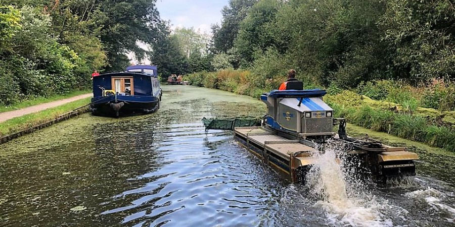 Truxor weed-cutting boat clears duckweed north Preston