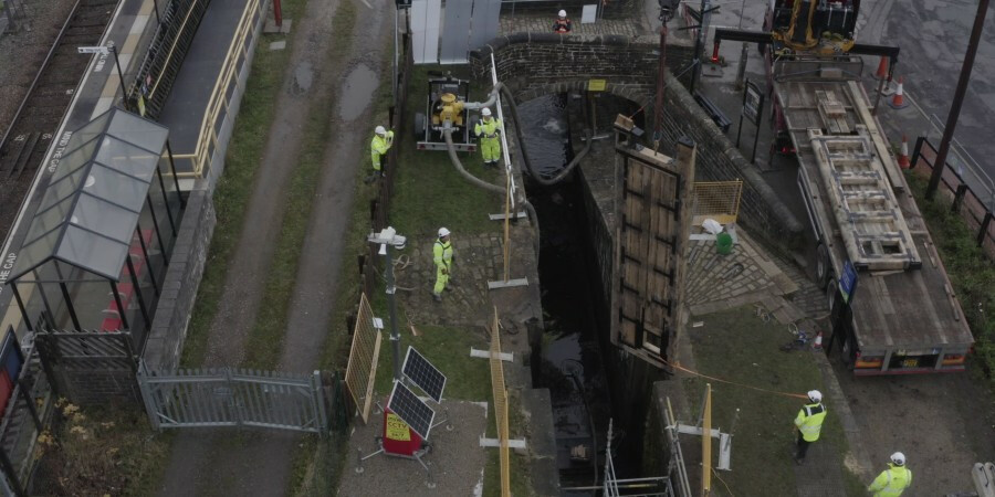 Above shot of workers lifting lock gate