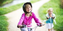 A young girl on a bicycle on the towpath