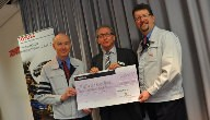 Danny Brennan, East Midlands Waterway Partnership Chair, receiving a cheque from representatives of Toyota.