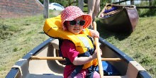 A child in a Canadian Canoe