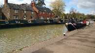 photo of grand union towpath outside Step back in time at The Canal Museum nestled at the heart of Stoke Bruerne. The museum itself is housed in a historic corn mill at the end of a row of traditional canal cottages standing on the edge of the Grand Union