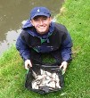 Ben Sharratt netting fish on the Trent & Mersey